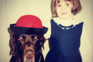 Old photo of young girl with her dog