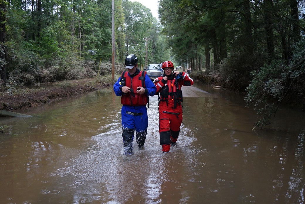 The ASPCA's Disaster Response Team wades into the flood waters in Louisiana.