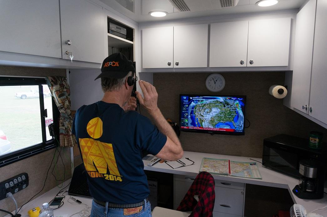ASPCA volunteer watching weather reports