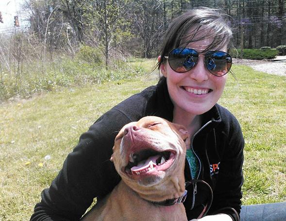 ASPCA responder posing with happy pit bull