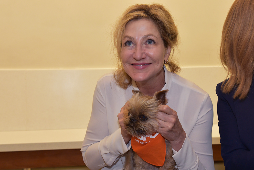 Edie Falco with a small dog