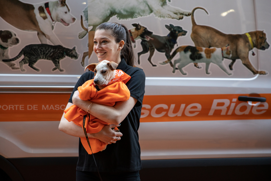 Woman and dog in front of relocation vehicle