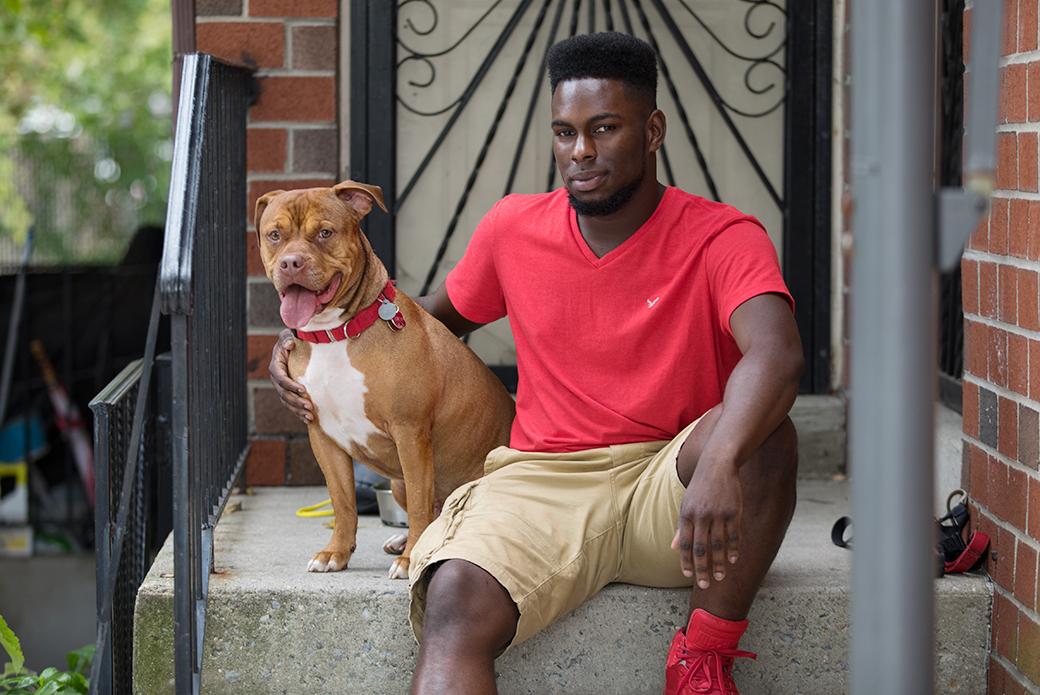 Gemar and Juice sitting on their homes doorstep