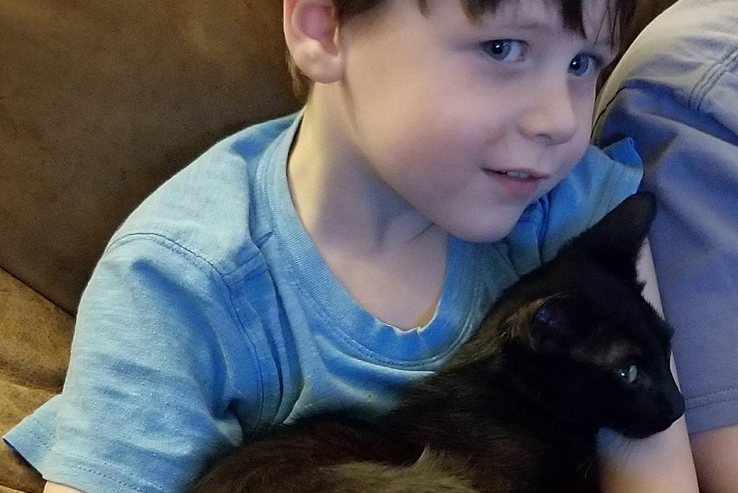 Steven's son and one of the rescued cats