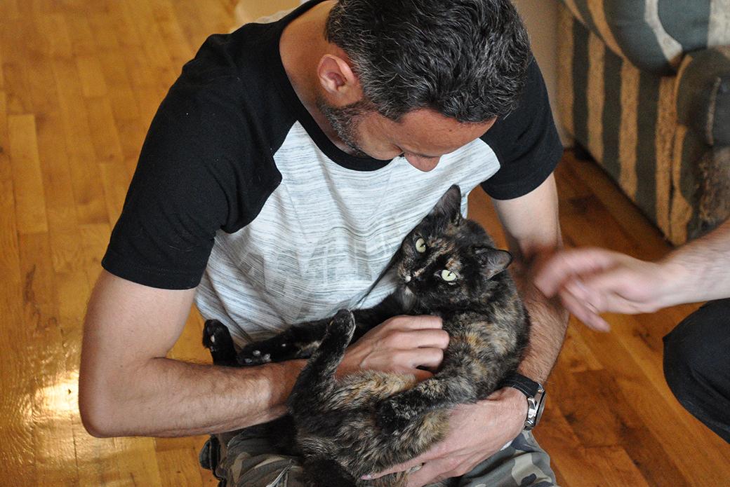 Jose V holding his cat Mara