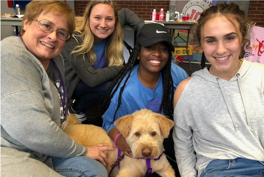 Kay and Winnie with students at a college event