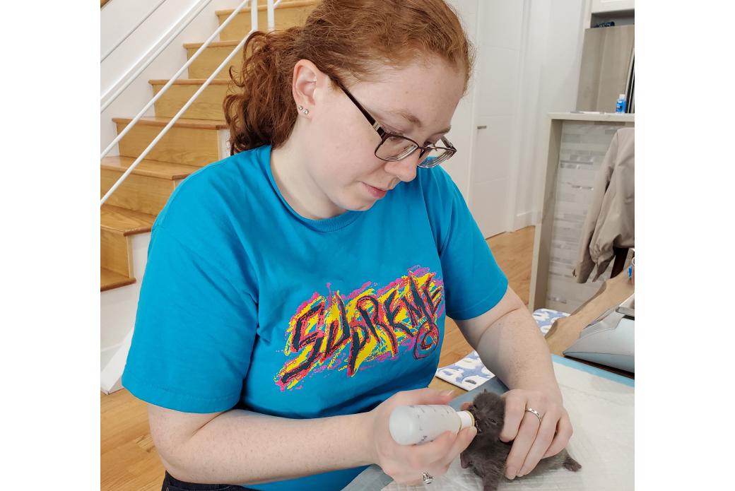 Heidi bottle feeding a kitten