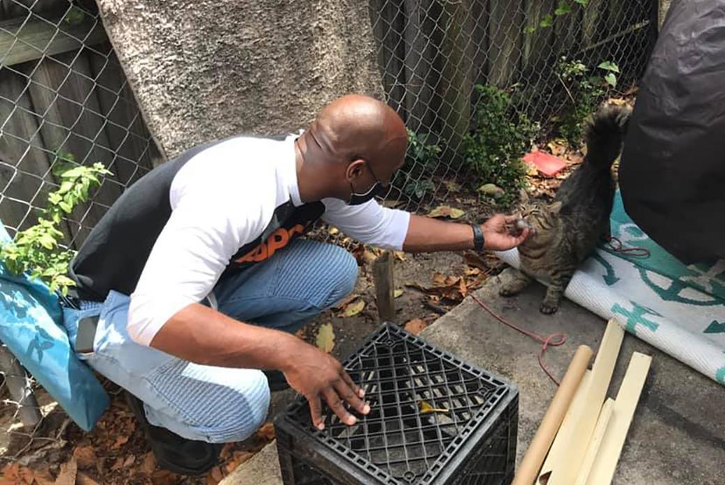 Marlon with one of Tony's cats