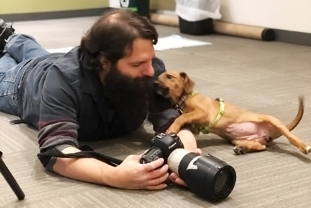a photographer with a small dog