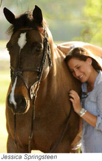 Jessica Springsteen standing next to a horse