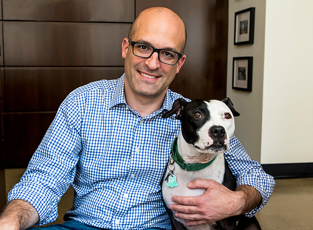 Matt Bershadker with a black and white pitbull