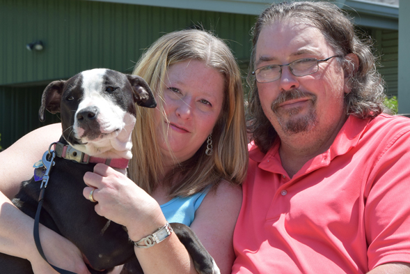 Dog fighting victim and new parents