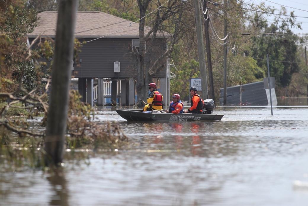 Responders boating through water