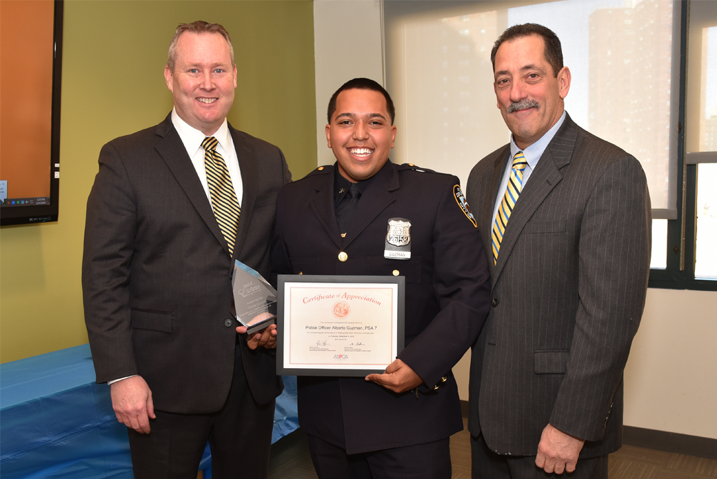 Police Officer Alberto Guzman with Howard Lawrence and Michael Mugan