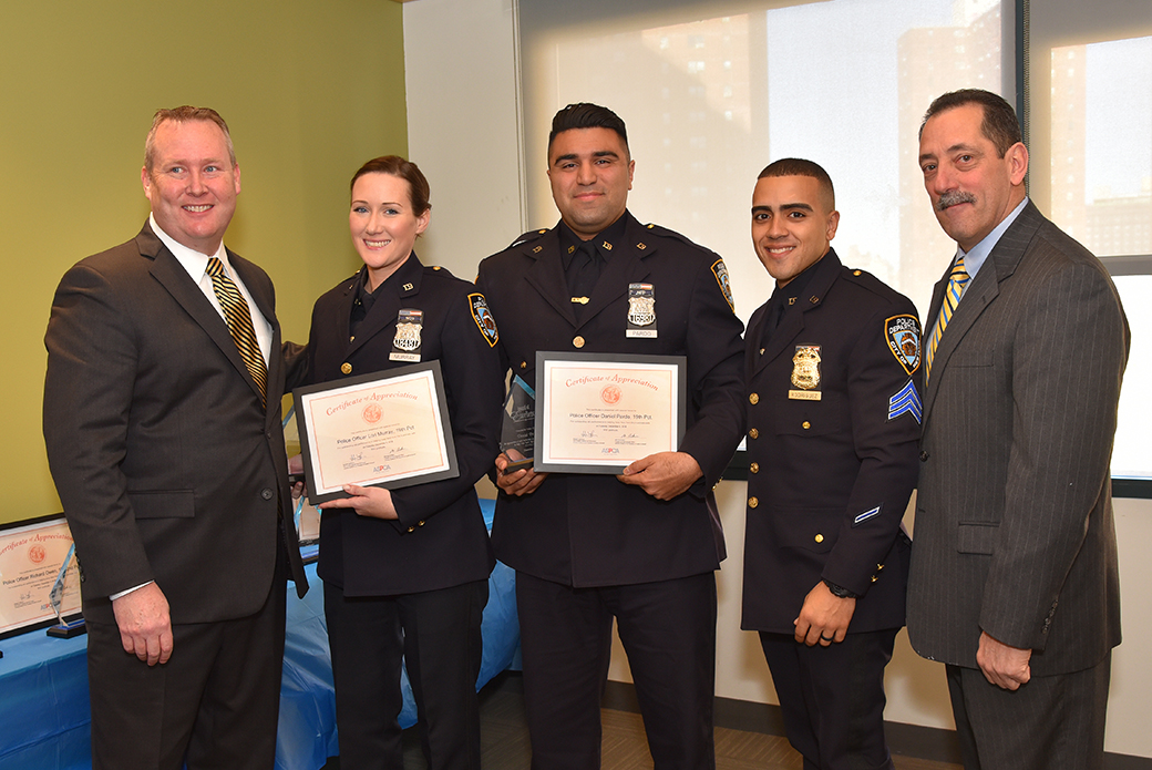 Police Officers Lori Murray and Daniel Pardo with Howard Lawrence and Michael Mugan.