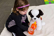 Take photos of your child with his or her plush rescue pet