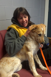 Cheryl Suydam, Rehabilitation Counselor at the ASPCA Behavioral Rehabilitation Center with dog