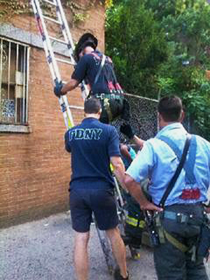 FDNY climbing up ladder