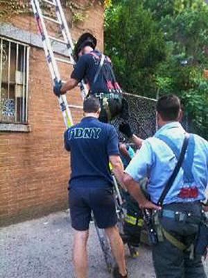 FDNY climbing up ladder