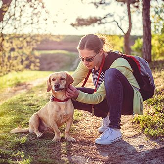 a woman and dog on a walk