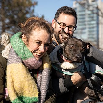 Happy couple with their dog at the park