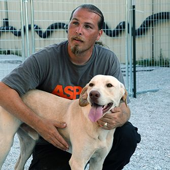 Tim Rickey and a rescued dog
