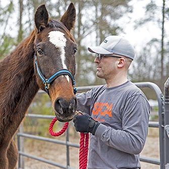 Matt Bershadker with a horse