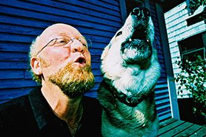 Man and his dog howl on a porch