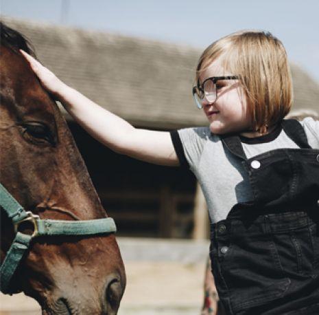 Girl petting horse